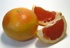 Grapefruit is a hybrid of orange and pomelo, the taste of this remarkable fruit is very rich sweet sour with bitterness. royalty free stock image