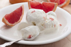 Grapefruit Ice Cream. Homemade ice cream with fresh organic grapefruit stock photos