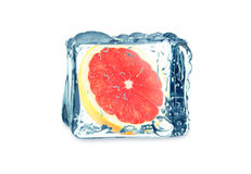 Grapefruit and ice cube Stock Images