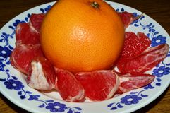 Grapefruit. Image of a grapefruit and cut into slices Royalty Free Stock Photos