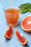 Grapefruit juice and fresh grapefruit Stock Photos