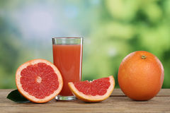 Grapefruit juice and fresh grapefruits in summer Stock Photos
