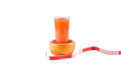 Grapefruit juice. Fresh grapefruit juice on a white background stock photography