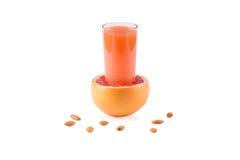 Grapefruit juice. Fresh grapefruit juice on a white background stock photo