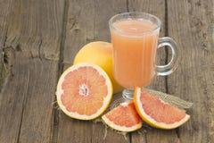 Grapefruit juice and frish fruits Stock Images