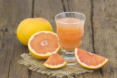 Grapefruit juice and frish fruits Royalty Free Stock Image