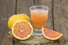 Grapefruit juice and frish fruits Royalty Free Stock Photo