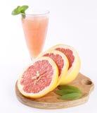 Grapefruit juice and fruit Stock Photos