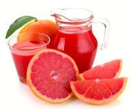 Grapefruit juice and fruit Stock Image
