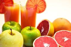Grapefruit juice and fruits. Isolated on white Stock Image