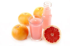 Grapefruit and juice in a glass Royalty Free Stock Photos