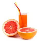 Grapefruit and juice in glass Stock Photography