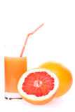 Grapefruit and juice in glass Royalty Free Stock Image