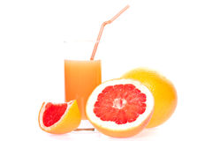 Grapefruit and juice in glass Stock Image