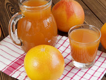 Grapefruit juice in glass Royalty Free Stock Photos
