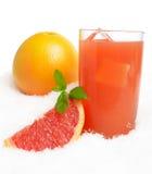 Grapefruit juice,ice cubes with halved grapefruit on ice on white Stock Image
