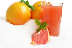 Grapefruit juice with ice and quarter with mint on ice on white Stock Photography
