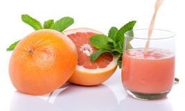 Grapefruit juice poured into a glass Royalty Free Stock Images