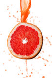Grapefruit juice splashing Stock Images