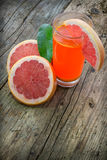 Grapefruit juice. In a wooden surfice Royalty Free Stock Images