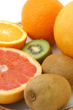 Grapefruit kiwi and orange. Ripe orange grapefruit and kiwi on dish Royalty Free Stock Images