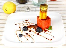 Grapefruit, kiwi and orange cubes with chocolate sauce Stock Photography