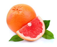 Grapefruit with leaves Stock Photography