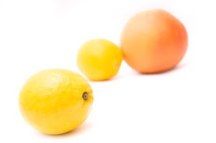Grapefruit and lemon. Ripe juicy grapefruit and lemon isolated royalty free stock photos