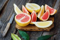 Grapefruit and lemon cut slices on grey background Stock Images