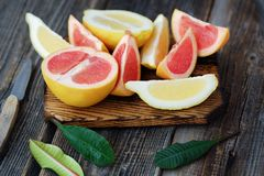 Grapefruit and lemon cut slices on grey background Stock Photos