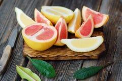 Grapefruit and lemon cut slices on grey background Royalty Free Stock Photo