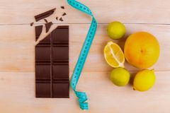 Fruits for a healthy diet vs chocolate stock photos