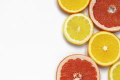 Grapefruit and lemon slices on white background. Tropical bright juicy fruit vegetarian healthy diet flat lay banner. Art stock photography