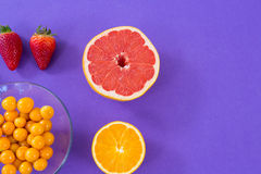 Grapefruit, lemon, strawberry with healthy breakfast Royalty Free Stock Photography
