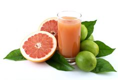 Grapefruit,lime and juice. Royalty Free Stock Photography