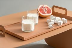 Grapefruit, marshmallows and glasses with milk Stock Photography