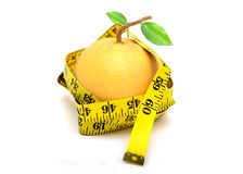 Grapefruit with measuring tape concept fitness Royalty Free Stock Image