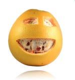 Grapefruit met gelukkig gezicht Stock Foto's