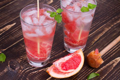 Grapefruit and Mint Mojito. On wooden background Stock Image