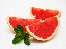 Grapefruit with mint. On a old white wooden background Royalty Free Stock Photos
