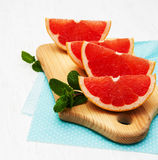 Grapefruit with mint. On a old white wooden background Royalty Free Stock Photography