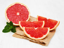Grapefruit with mint. On a old white wooden background Stock Photography