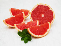 Grapefruit with mint. On a old white wooden background Stock Image