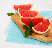 Grapefruit with mint. On a old white wooden background Stock Images