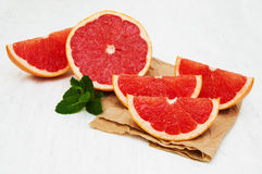 Grapefruit with mint. On a old white wooden background Stock Photo