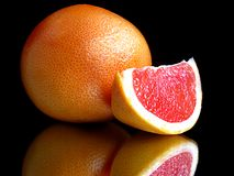 Grapefruit with mirror Royalty Free Stock Images