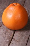 Grapefruit on the old wooden table closeup Stock Photo