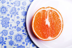 Grapefruit On Plate On Napkin Stock Photo