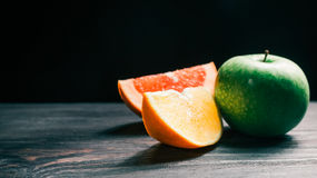 Grapefruit, orange and apple Royalty Free Stock Photography