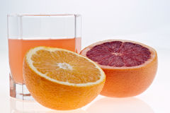 Grapefruit, orange and juice Royalty Free Stock Photo